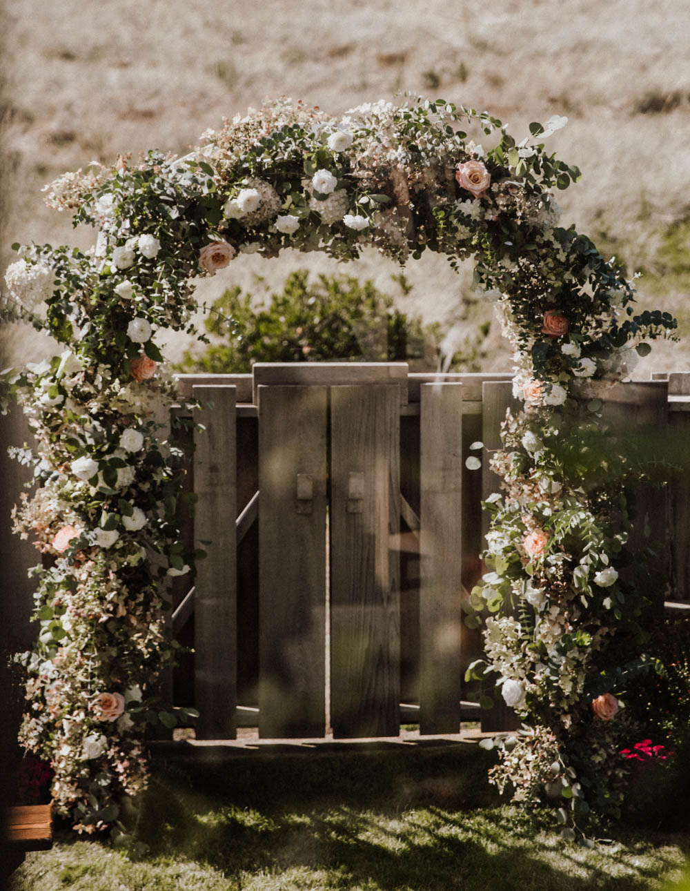 Oregon beach wedding flowers archway