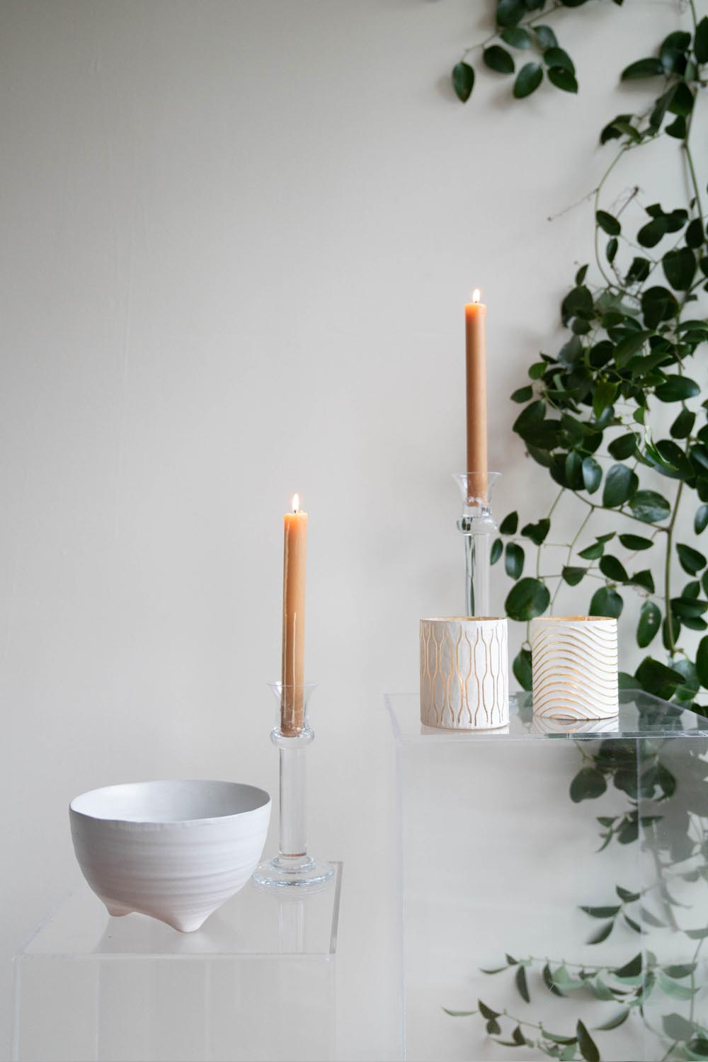Matte white vessels and clear candle holders